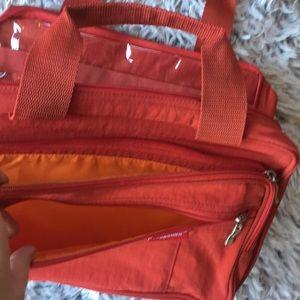 Baggallini Bags - Baggallini large red hanging toiletry bag